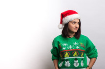 woman in an ugly Christmas sweater and santa hat