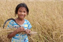 a girl child in the fields of Nepal