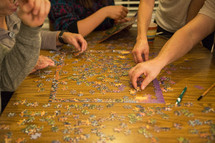 family working on a puzzle