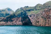 sea cave on sea cliffs along a coastline
