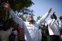 Haitian man praising God