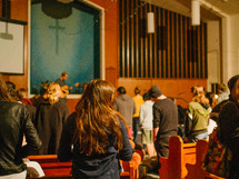 prayer and song during a worship service