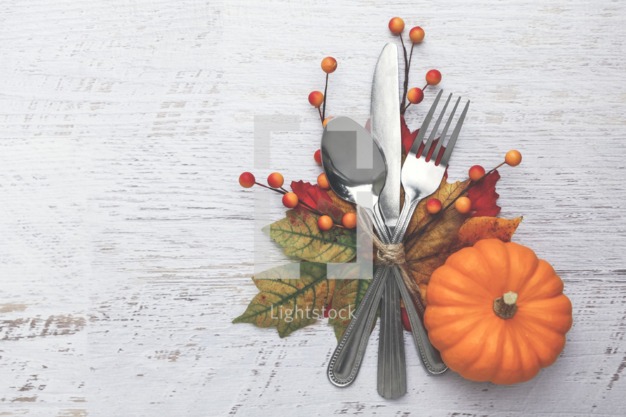 silverware and pumpkin
