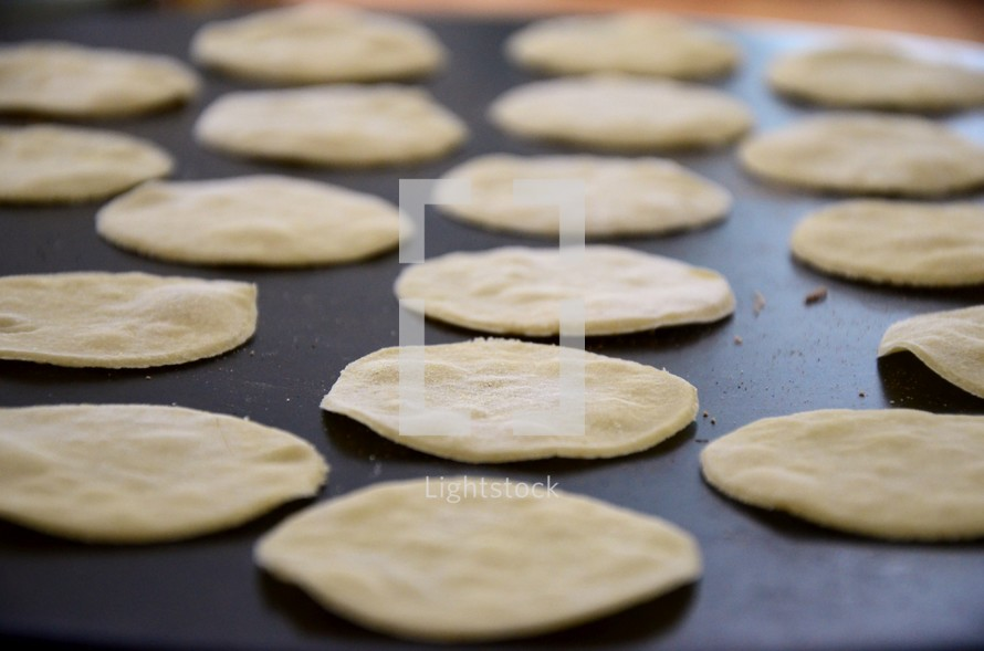 Matzah or (unleavened bread) cooking on a hot plate.