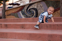 toddler boy climbing stairs