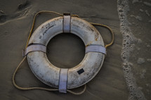 life preserver in the sand