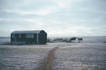 barn on a winter field