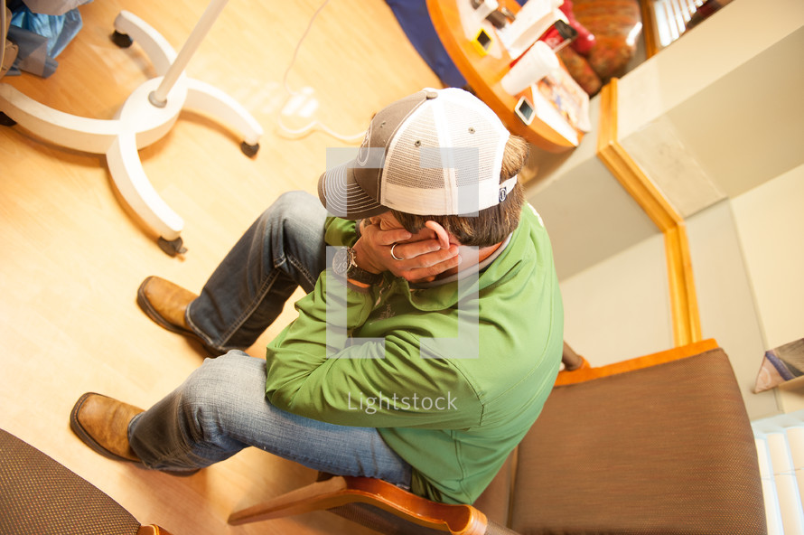 an anxious man in a hospital waiting room