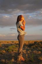 a girl praying outdoors