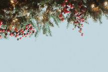 A Christmas garland border on white
