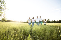 family standing together outdoors in a field