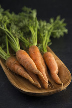 carrots in a wood bowl