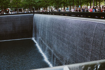 people visiting the 9/11 memorial