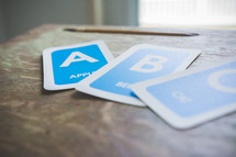 Alphabet flashcards on a table