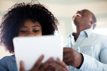 a couple looking at an iPad screen