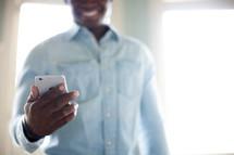 a man checking his cellphone screen