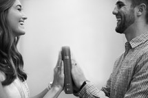 a couple making a promise to each other with their hands on a Bible