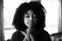 a woman in peaceful prayer
