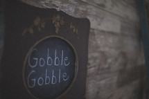 Gobble Gobble written on a chalk board for Thanksgiving