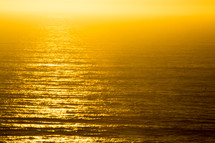 golden sunlight over the ocean