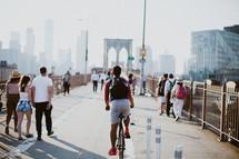 pedestrians crossing the Brooklyn bridge