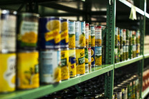 canned food on the shelves in a food pantry