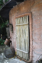 bamboo door on a mud hut