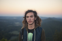 young man with dreads outdoors
