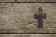A metal cross on wood