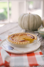 pumpkin and pumpkin pie on a table