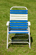 Lawn chair in the grass.
