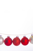 red and white Christmas ornaments hanging
