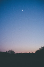 crescent moon in the night sky