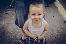 A smiling little boy.