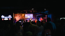 worship service, performance, musicians, music, on stage, man, woman, singers, guitar, band, concert