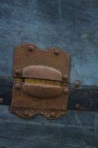 rusty hinge on a trunk