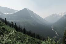 jagged mountain peak under a foggy sky