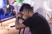 Man praying during worship.