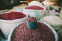scoop in a bucket of beans