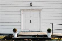 white doors of a church