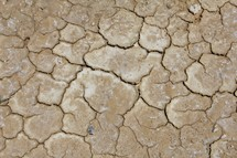 Parched clay soil at the bottom of a lake during a drought
