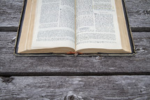 Old French Bible open on wood table