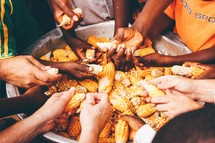 hands washing corn