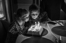 twins blowing out birthday candles