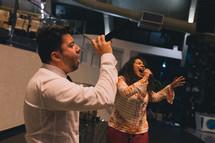worship music, man and women singing passionately