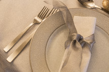 place setting and silver bow