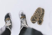 boots and sandals in snow