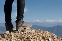 boots standing on a mountaintop
