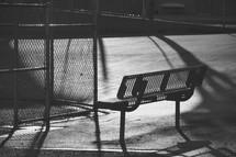 park bench an urban basketball court