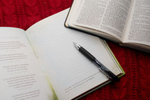 open journal and Bible